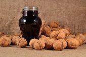 picture of walnut  - Jam from walnuts in glass jar and walnuts - JPG
