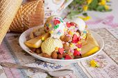 pic of banana split  - eating ice cream and banana cream with slices of banana and sweet grit in still life with acacias - JPG