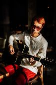 picture of guitarists  - asian handsome fashion guitarist artist man play acoustic guitar in cafe - JPG