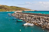 stock photo of gozo  - Entrance in bay seafront with lighthouse on seafront - JPG
