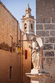 foto of carmelite  - Ancient narrow street the Carmelite convent and medieval statue of Jesus in the old city of Mdina - JPG