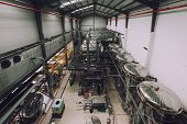 image of silos  - Industrial interior of an alcohol factory with silos - JPG