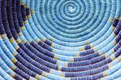 foto of indian blue  - A Close up photo of a Native American Style Indian basket with a circular pattern and cool blue and purple colors - JPG