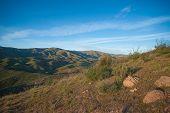 stock photo of wilder  - Rocks and boulders form California hillside in the Mojave desert wilderness - JPG