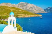 stock photo of greek  - Blue dome of Greek church with sea bay of Greek Island - JPG