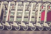 picture of trolley  - Close up trolleys luggage in a row in airport retro filter effect - JPG