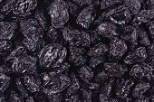 stock photo of prunes  - Top view of prunes as background texture - JPG