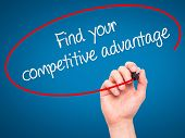pic of differential  - Man Hand writing Find your competitive advantage with marker on transparent wipe board - JPG