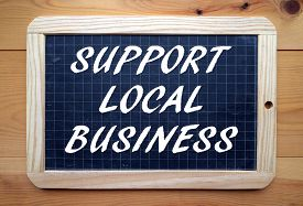foto of slating  - The phrase Support Local Business in white text on a slate blackboard - JPG