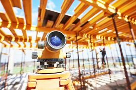 stock photo of geodesic  - Surveyor equipment level theodolite outdoors at construction site - JPG