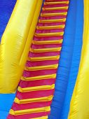 stock photo of inflatable slide  - Ladder on inflatable fun slide - JPG