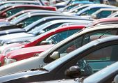 pic of parking lot  - Long telephoto view of cars in parking lot - JPG