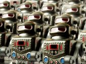 stock photo of inhumane  - army of vintage toy clockwork marching robots - JPG
