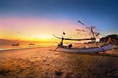 stock photo of beach sunset  - Drifting boat on the beach at sunset time  - JPG