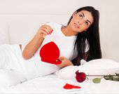 stock photo of home is where your heart is  - Beautiful Brunette Woman At Home Was A Gift From A Loved One - JPG