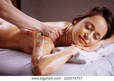 poster of Body care. Spa body massage treatment. Woman having massage in the spa salon