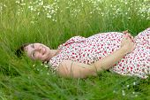 Pregnant Woman Lie In Chamomile