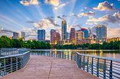 Austin, Texas, USA downtown skyline over the Colorado River. poster