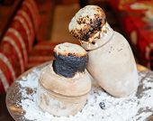 foto of testis  - Testi kebaba Turkish delicacy cooked in a clay pot sealed with dough on brass charger plate - JPG