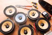 Electronics hobby. Tweaking audio. Audio speakers on a work table. poster