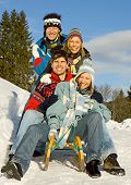 stock photo of toboggan  - friends having fun in winter - JPG