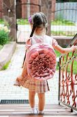 pic of bagpack  - Young school girl with pink bagpack waits standing on stairs - JPG
