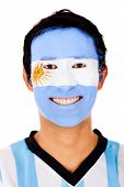 Happy Argentinean man with the flag painted on his face - isolated