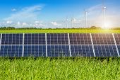 Solar Panels On Cornfield And Rice Golden Yellow With Wind Turbines Against Mountanis Landscape Agai poster