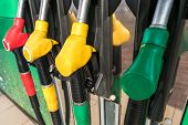 Gas And Petrol Station. Guns For Refueling At A Gas Station. Detail Of A Petrol Pump Different Color poster