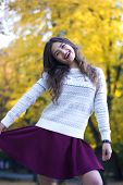 Excited Happy Fall Woman Smiling Joyful And Blissful Holding Autumn Leaves Outside In Colorful Fall  poster