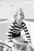 Little Sailor On Boat. Happy Little Boy On Yacht. Boat Trip By Sea Or Ocean. Summer Vacation. Childh poster