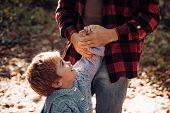 Parental Support. Help Kid Explore World. Dad Hold Hand Of Little Boy. Manly Father Upbringing Littl poster