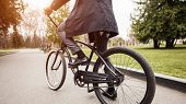 Active Man Going To Work By Bike, Feet On Pedals, Crop, Closeup poster