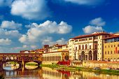 View From The River To The Famous Italian Medieval Bridge - Ponte Vecchio In Florence With Blue Sky  poster