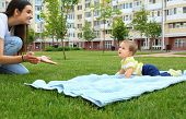 Adorable Little Baby Crawling Towards Mother On Blanket Outdoors poster
