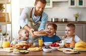 Happy Family Father With Many Children Feeds His Sons And Daughter In Kitchen With Breakfast poster