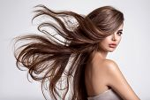 Portrait of a beautiful woman with a long hair. Young  brunette model with  beautiful hair - isolate poster
