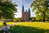 People Relaxing At The Kings Garden Next To Rosenborg Castle poster