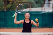 Tennis Player. Cheerful Beautiful Girl Playing Tennis, Prepares To Serve A Tennis Ball. Dressed In B poster