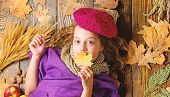Fashion Trend Fall Season. Girl Lay Wooden Background Fallen Leaves Top View. Knitted Accessory Fash poster