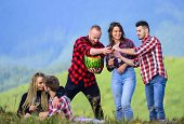 Friends Enjoy Vacation. Hike Picnic. People Eating Food Drink Alcohol. Youth Having Fun Picnic In Hi poster
