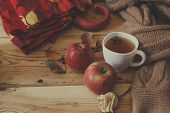 Cold Autumn Days. A Cup Of Tea With Fall Leafs And Dried Rose Flowers On Wooden Table. Warming Herba poster