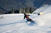 Back View Of Man Skiing On Slope With Fresh New Powder Snow. Artificial Snowfall In Sunny Day. Elect poster