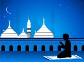 foto of namaz  - View of Mosque or Masjid  on night background with silhouette of a boy reading Namaz  - JPG