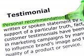 stock photo of tribute  - Definition of the word Testimonial Personal Recommendation highlighted with green marker - JPG