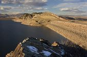 image of horsetooth reservoir  - two rock dams of Horsetooth Reservoir and Centennial Road at foothills of Rocky Mountains in Colorado near Fort Collins - JPG