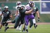 VIENNA, AUSTRIA - MARCH 31 RB Dusty Thornhill (#2 Vikings) is tackled by LB Jakob Baran (#15 Dragons