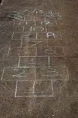 image of hopscotch  - Hopscotch on paving for children to play on - JPG