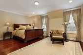 stock photo of master bedroom  - Master bedroom in luxury home with cherry wood flooring - JPG