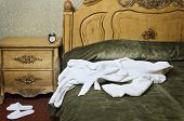 picture of housecoat  - White Bathrobe On The Old Antique Bed - JPG